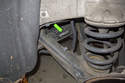 Working at rear control arm (left side shown in photo), pull ABS sensor electrical connector out of plastic mount (green arrow).
