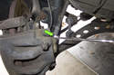 Working at brake caliper using a 14mm line wrench, loosen brake hose.
