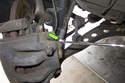 Working at brake caliper using a 14mm line wrench, loosen brake hose.