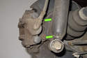 Working behind brake caliper: Remove two 16mm brake caliper bracket mounting bolts.