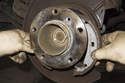 Remove parking brake shoes from vehicle, then separate remaining parts.