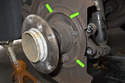 Then lightly grease brake shoe to backing plate contact points.