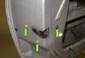 Next, remove the T30 Torx door latch fasteners (green arrows).