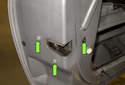 Next, remove the T30 Torx door latch fasteners (green arrows).