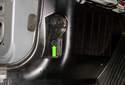 Working at the kick panel trim, rotate locking tab 90 degrees counterclockwise to unlock.