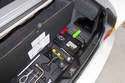 The battery in BMW Z3 models is located in the right side of trunk, under the carpet (green arrow).