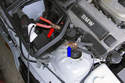 Connect one end of positive jumper cable to positive (+) battery terminal of vehicle with good battery.