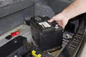 Lift battery up and remove from trunk.