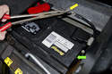 Before installing new battery, check that battery vent line is not pinched, in good condition and properly routed.
