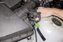 Then remove the secondary air inlet hose from the air filter housing by pulling it straight off.