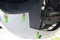 Working at left and right lower corners of the bumper, remove bumper 8mm fasteners (green arrows).