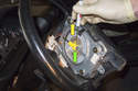 Lift the airbag off the steering wheel to expose the electrical connectors.