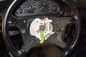 Using a breaker bar with a 16mm socket, remove steering wheel center bolt.