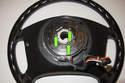 Flip the steering wheel over, remove the three T10 Torx clock spring screws (green arrows).