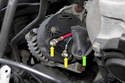 Working at the back of the alternator, open the rubber cover (green arrow) to expose the electrical connections.