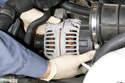 Next remove alternator from mounting bracket by rocking back and forth while pulling up and off bracket.
