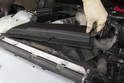 4-cylinder: Lift up and remove the plastic cover from the radiator support.