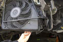 Slide the cooling fan down out of the radiator support and remove from the vehicle.