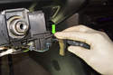 Press the cruise switch locking tab, then pull the switch straight out of steering column mount.