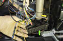 Pull the electrical connector junction (green arrow) off the steering column (yellow arrow).