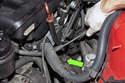 Follow the engine oil dipstick tube down toward engine mount.