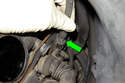 To adjust, rotate adjuster (green arrow) located at end of throttle cable housing.