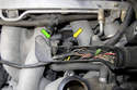 With the cover removed, you now have access to the camshaft position sensor (green arrow) and crankshaft position sensor (yellow arrow) electrical connectors.