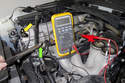 In this photo the wrench (green arrow) is away from the sensor (yellow arrow), so the DVOM reads about 12 volts.
