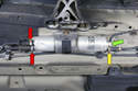 Late fuel filter assembly: This filter has three fuel lines connected, two at the back (red arrows) and one at the front (yellow arrow) and an integrated fuel pressure regulator (green arrow).