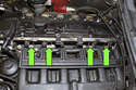 Next, remove four 10mm fuel rail fasteners (green arrows).
