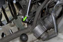 Loosen the pressure line using a 17mm crows foot wrench (green arrow).