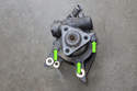 Once pump is removed, transfer the front power steering pump mounting bracket from old pump to new.
