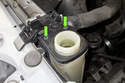 Working at expansion tank, remove cap.