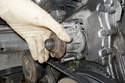 Once water pump O-ring has cleared timing cover, you can remove it by hand.