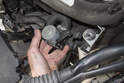 Then, pull the heater valve out of the mount.