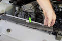 Remove rubber seal from top of radiator by pulling up.