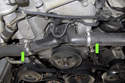 When replacing the thermostat, I suggest replacing both coolant hoses (green arrows) that connect to it.