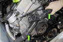 With hose clamps moved, now you can remove the radiator hoses from the thermostat (green arrows).