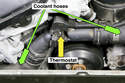 When replacing the thermostat (yellow arrow), I suggest replacing both coolant hoses(green arrows) that connect to it.