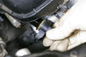 Pull camshaft sensor out of cylinder head, be ready to any catch dripping oil in a rag.