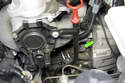 The crankshaft sensor is located below the starter motor.