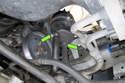 Working at the bottom of the power steering reservoir, remove both hose clamps.