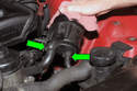 Next, remove the reservoir from the mounting bracket by sliding it up and out so you can access hoses at bottom.