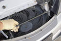 Once all the nuts are removed, lift the cooling loop up and feed out of body.