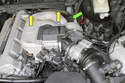 The crankcase breather is located at the back of the intake manifold (green arrow).