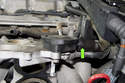 Remove the breather valve hose by pulling it straight off the valve.