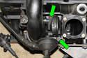 Remove crankcase breather valve fasteners (green arrows) then remove crankcase breather valve from engine.