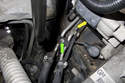 Next, you have to remove the fuel hoses and detach the fuel lines from the mounting bracket.