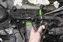 Then, pull both hoses off of the coolant pipe.