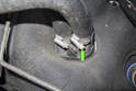 If you want to replace the heater hose that runs to the coolant pipe, loosen the clamp at the heater core connection (green arrow) and remove hose.